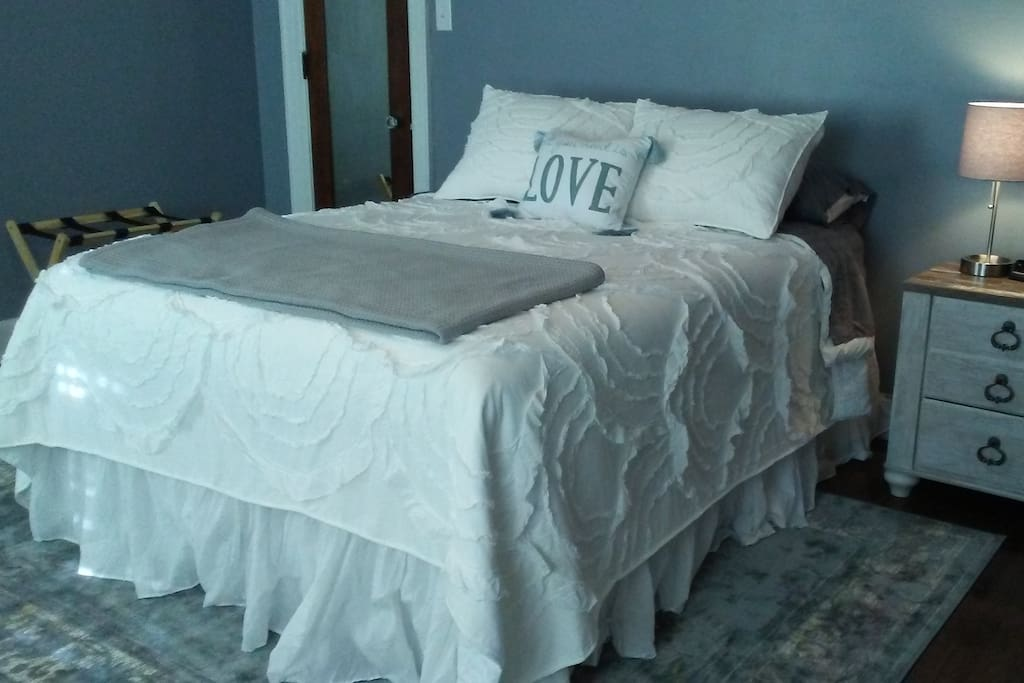 Comfortable Queen size bed with Shabby Chic décor.