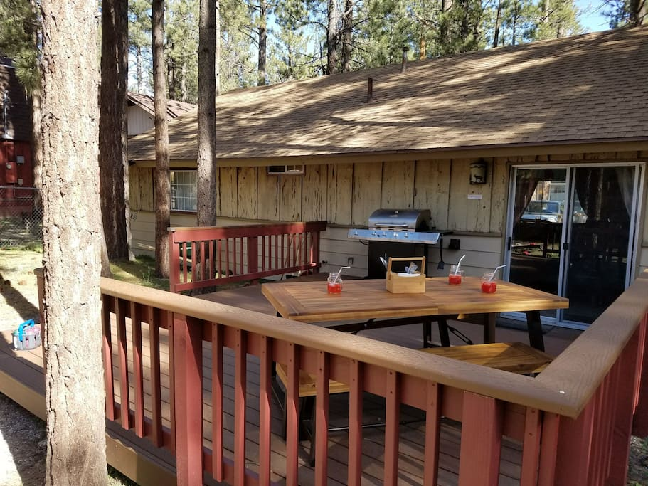 backyard deck with grill and picnic table