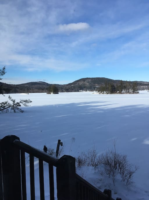 The lake is frozen for winter fun.