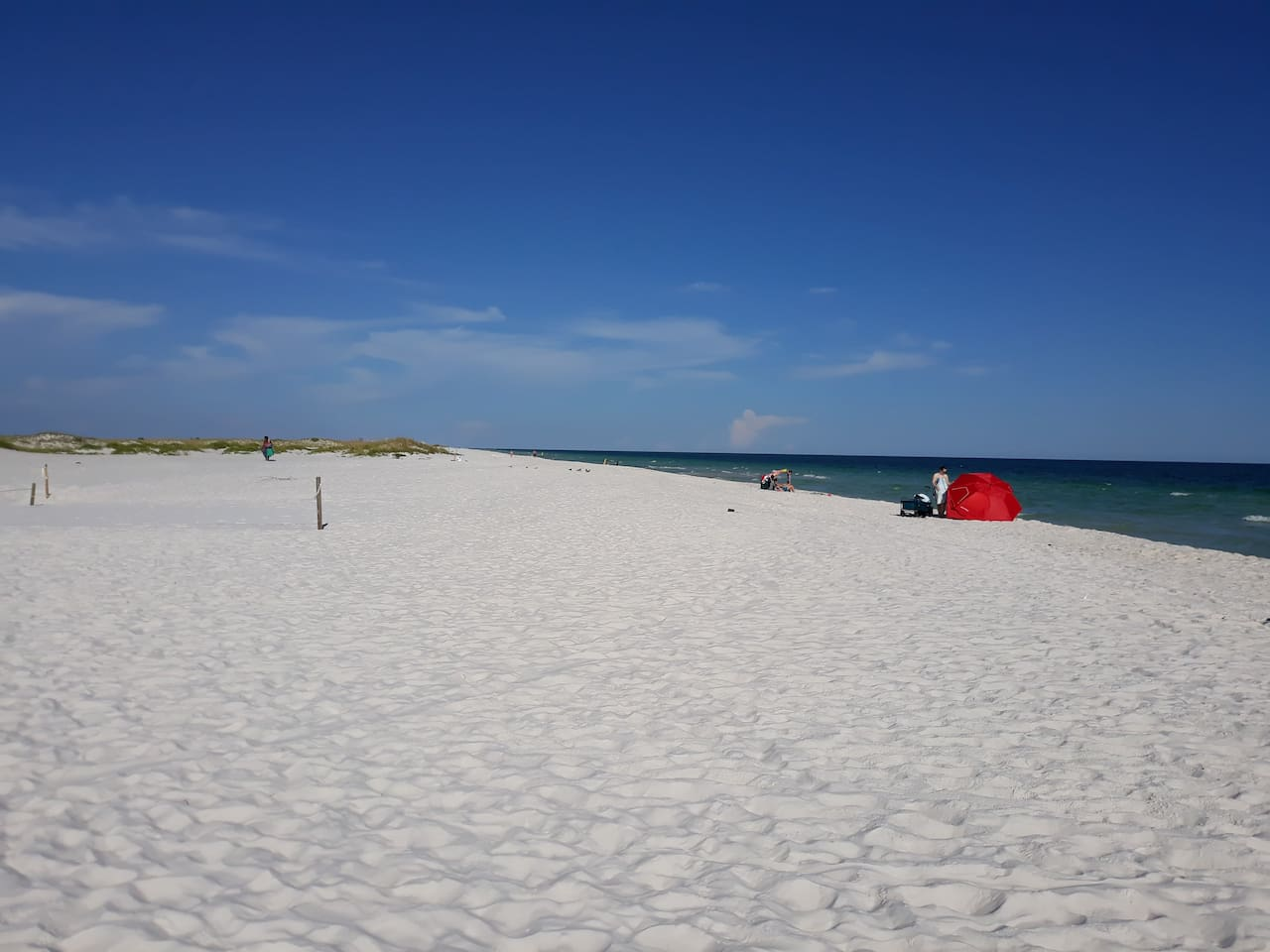 Beautiful wide long almost vacant white sand beaches
