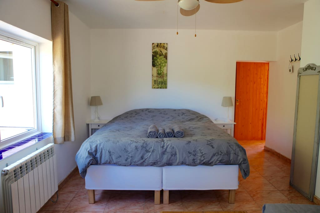 Room 2, a kingsize bed and a sofa bed, two windows and a private bathroom