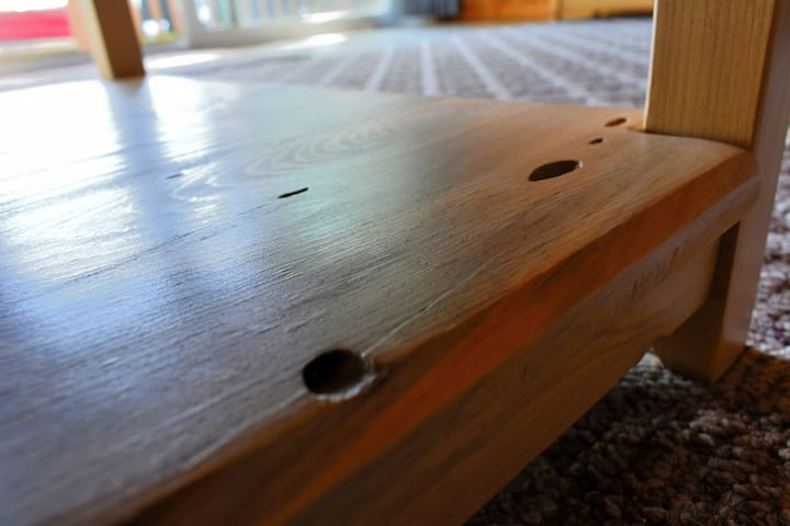 The coffee table is hand made from standing dead, beetle-killed Lodgepole pine.