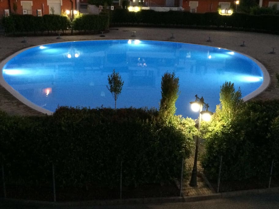 View of the pool from the terrace at night.