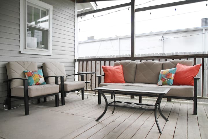 Cozy furniture on spacious outdoor deck.