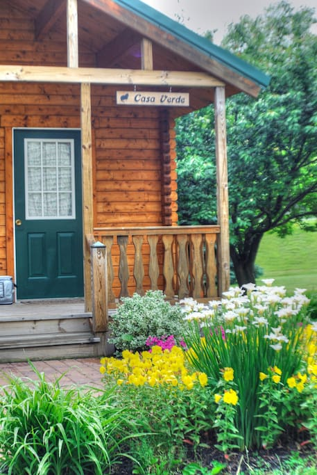 Gardens and flowers as well as beautiful views are plentiful from the porch.