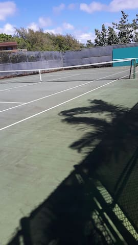 Tennis courts beside pool area
