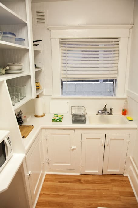 Efficient, fully equipped kitchen comes with all the cooking supplies you need; built-in water filter, cutting boards, microwave, toaster, and coffee maker.