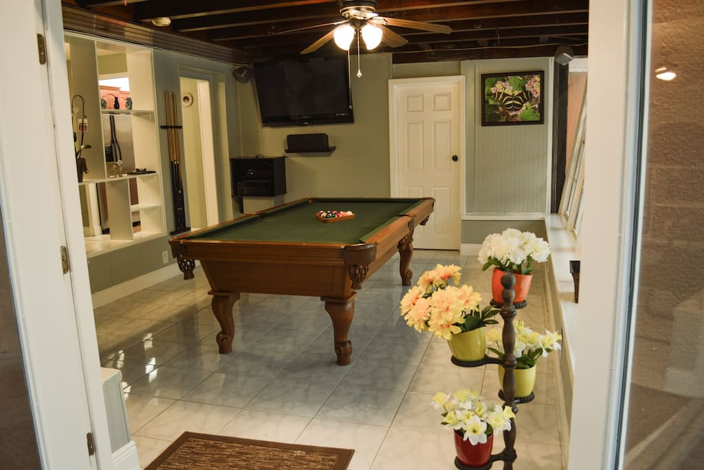 Billiards Table room equipped with large screen tv.