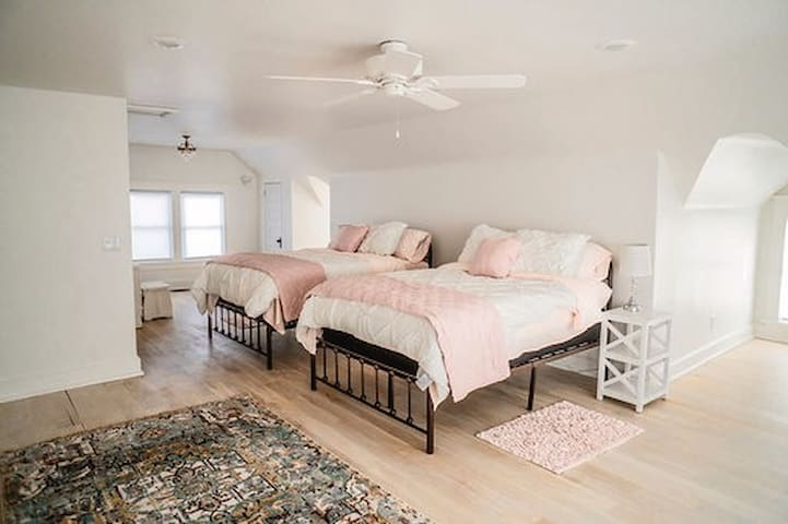 3rd story loft is featuring 2 full sized beds.  It has it's own kitchenette, full bathroom, and of course, a little Southern Belle Charm.