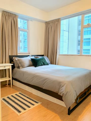 Spacious bedroom with a super comfortable queen-sized bed and black-out curtains. Kick back and snooze up after a long day exploring the city!