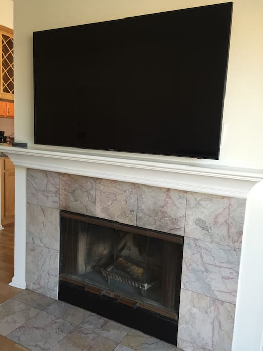 """60"""" tv and fireplace!!"""