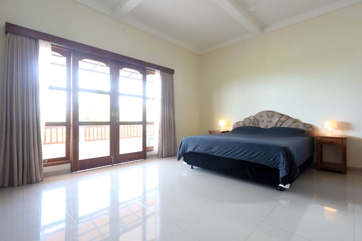 Large master bedroom (8m x 6m) on the second floor with private balcony (8m x 6m)