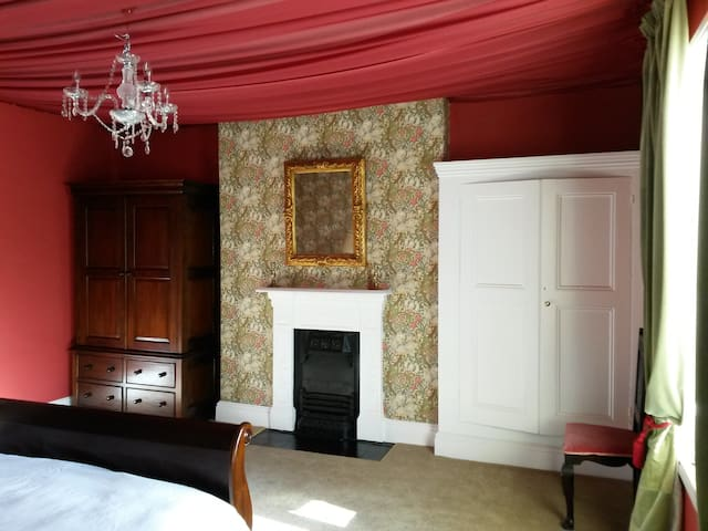 Wardrobe and built in TV in bedroom