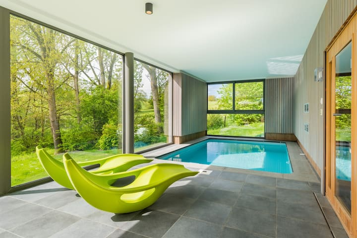 Modern villa with indoor swimming pool, in the middle of the Noiseaux nature