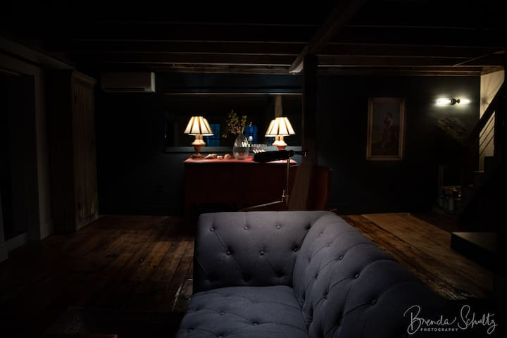 """Theatre-style living room features a 75"""" Samsung Smart TV. Velvet draperies block out light for ultimate movie viewing on cool Maine nights."""