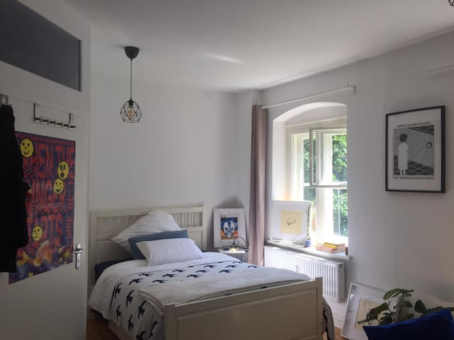 Big and bright room in central shared apartment