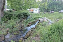Watercress Cottage as seen from the small waterfalls along the creek - interior photos at bottom of photo stream