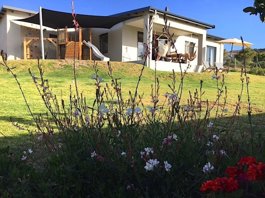 Serenity on Seascape offers a large open lawn, with a fantastic play area for kids.