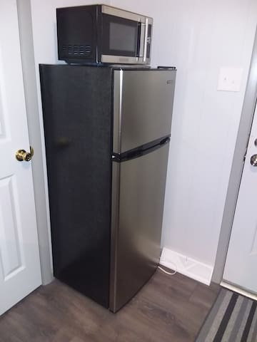 Refrigerator and microwave in the kitchen