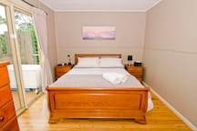 Main bedroom opens on to deck over water