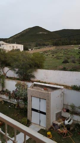 Jolie chambre vue sur montagne - Boumhel Elbassatine - Huis