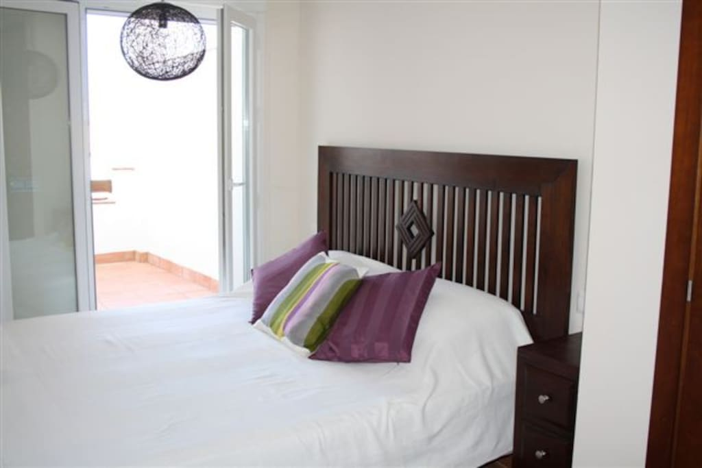 Double room with private terrace access and en-suite .