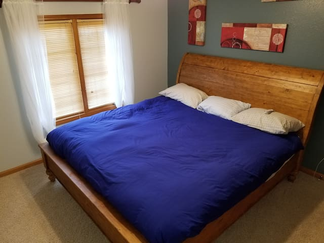 Your bedroom! King sized bed with charger, luggage rack, hangars - everything you need for a great night's rest!