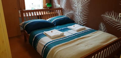 A cosy room with double bed in a nice town