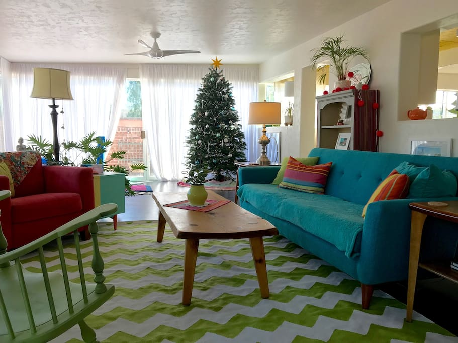 Bright and happy living room which overlooks the lush backyard, pool and Catalina Mountain views.