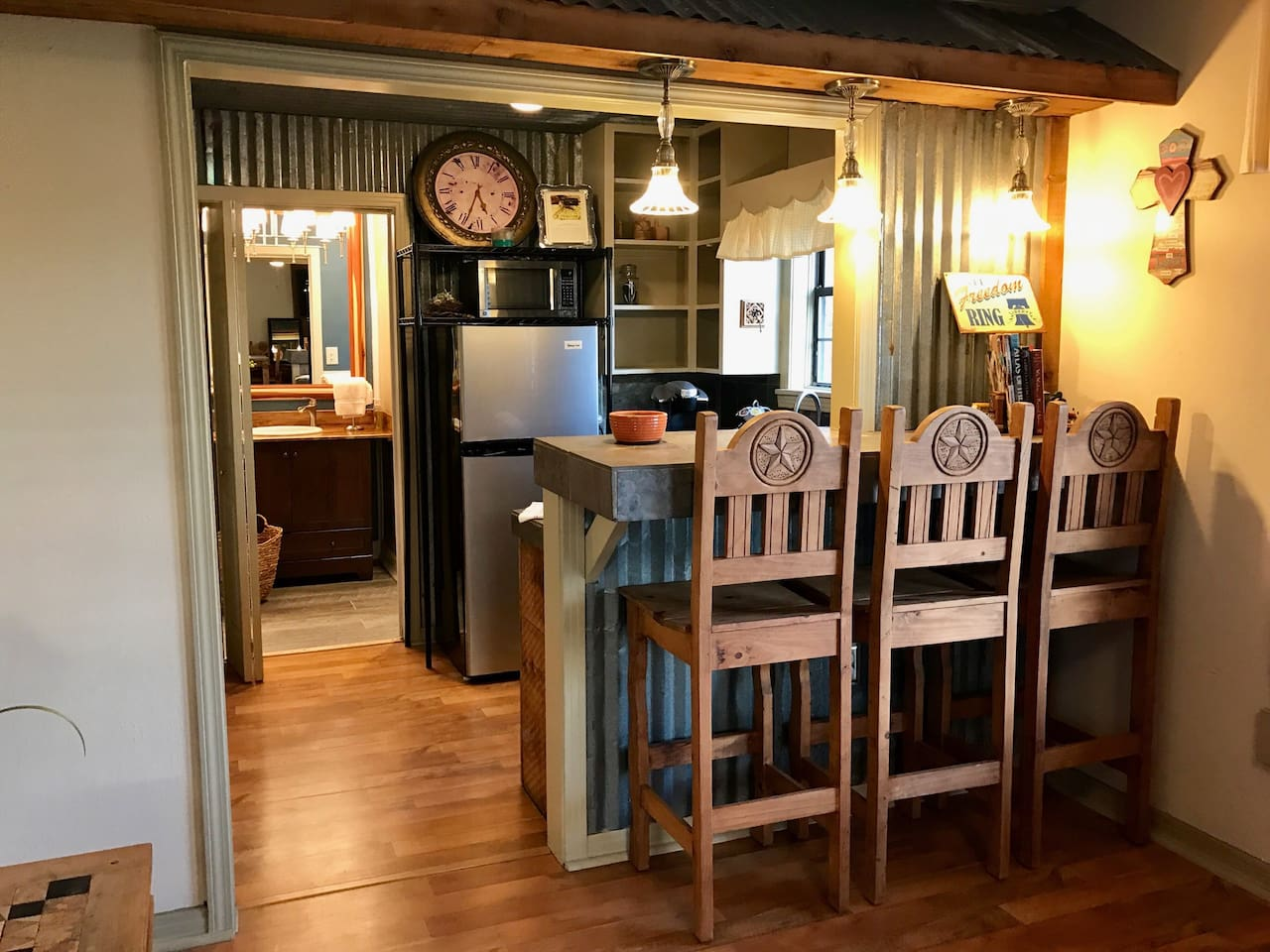 Kitchenette with microwave, mini refrigerator, coffee maker w supplies, sodas and water complimentary.