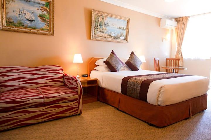 Twin Room (Queen & Sofa Bed)