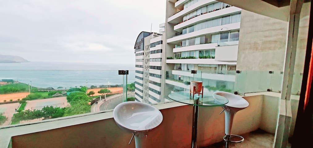 Habitación en departamento con vista al mar