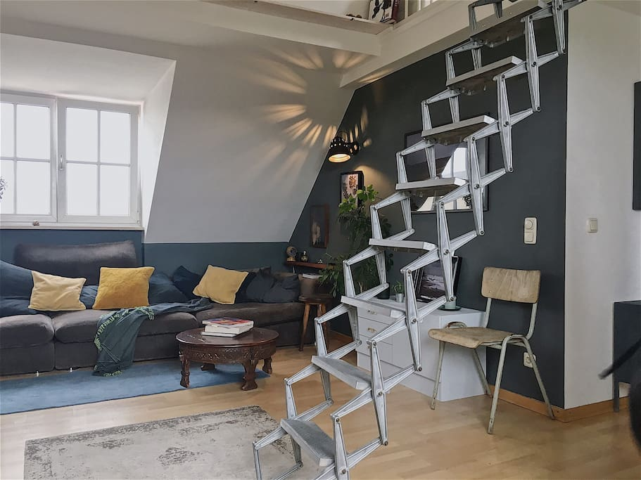 Living room with staircase to bedroom-gallery