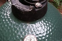 Our medium Big Green Egg can roast 12 lb turkey, smoke ribs, cook casserole and cakes...but it is tricky to use.  We urge you to go on line to watch videos, get recipes ahead of time.  We have tools, books, and wood for your fist adventure.