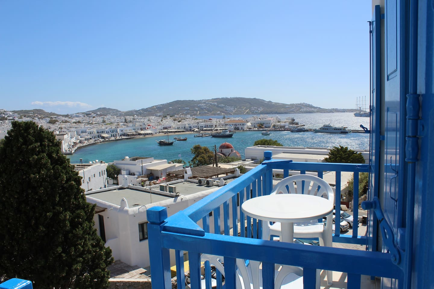That is the view of your veranda that you can enjoy  the magical  view of the Old port at Mykonos town.