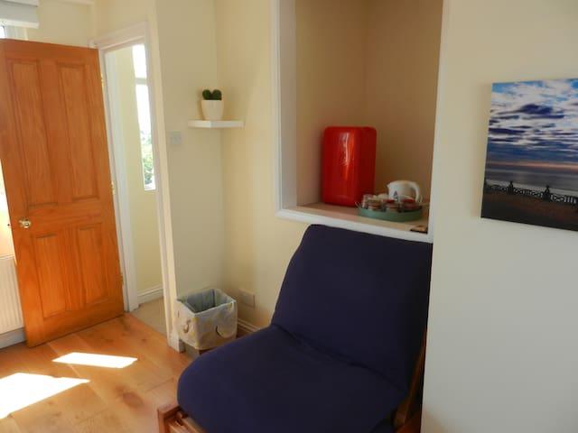 Chair plus red mini fridge behind it.