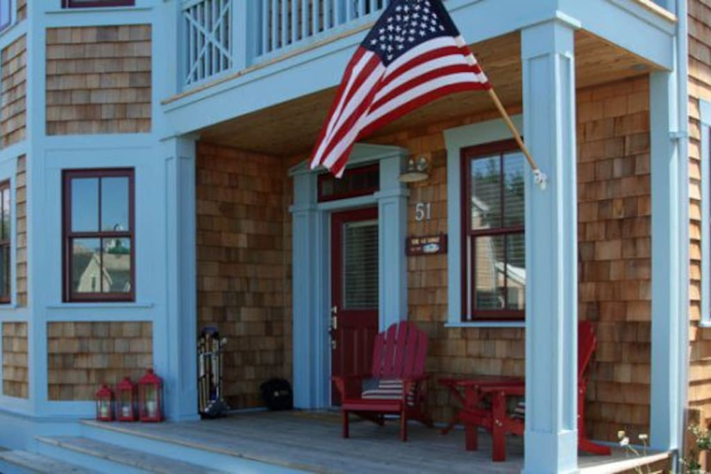 The Getaway front porch with Adirondack chairs