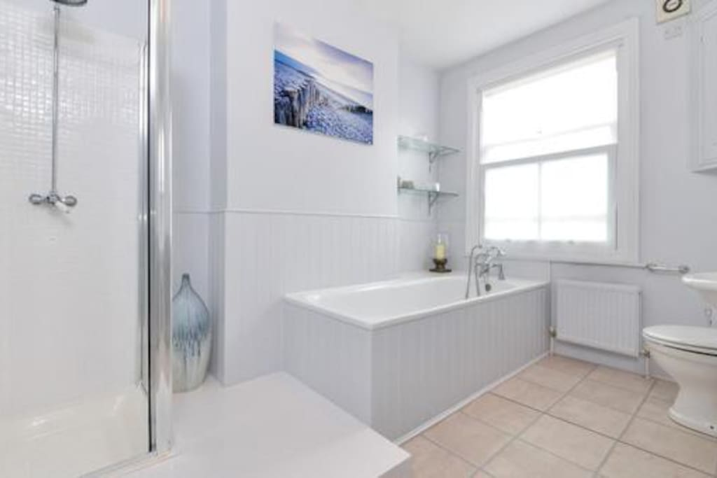Huge Bathroom with separate shower and bath