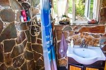 Stone shower in bathroom