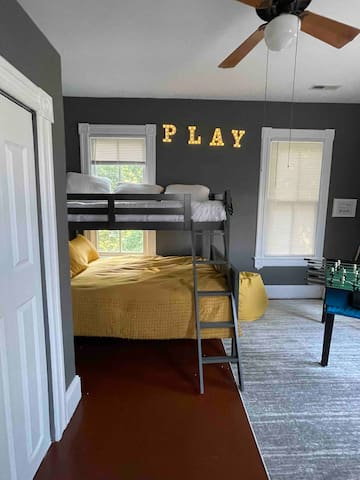 Bedroom 2 with twin over full bunk beds and play area