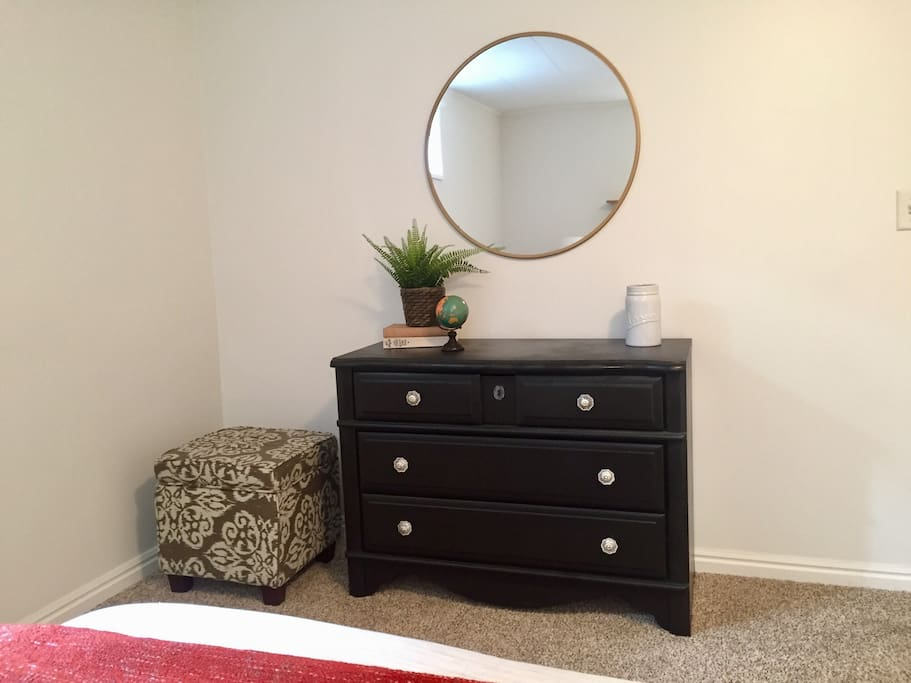 Bedroom 1: Dresser and closet available for guest use