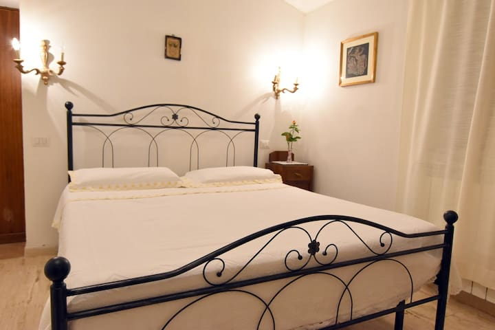 The bedroom has a comfortable double bed