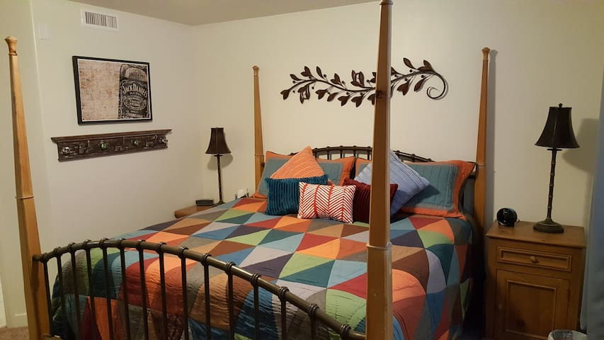 Large comfortable king size bed in the master bedroom.