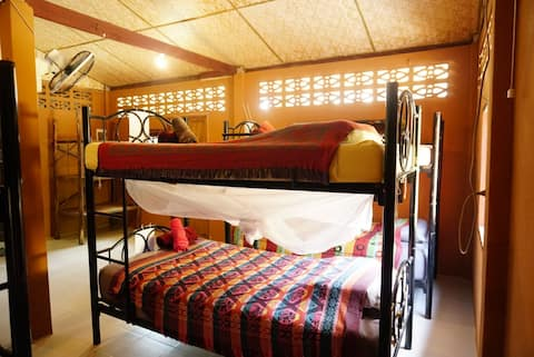 A bed in the riverside shared dormitory