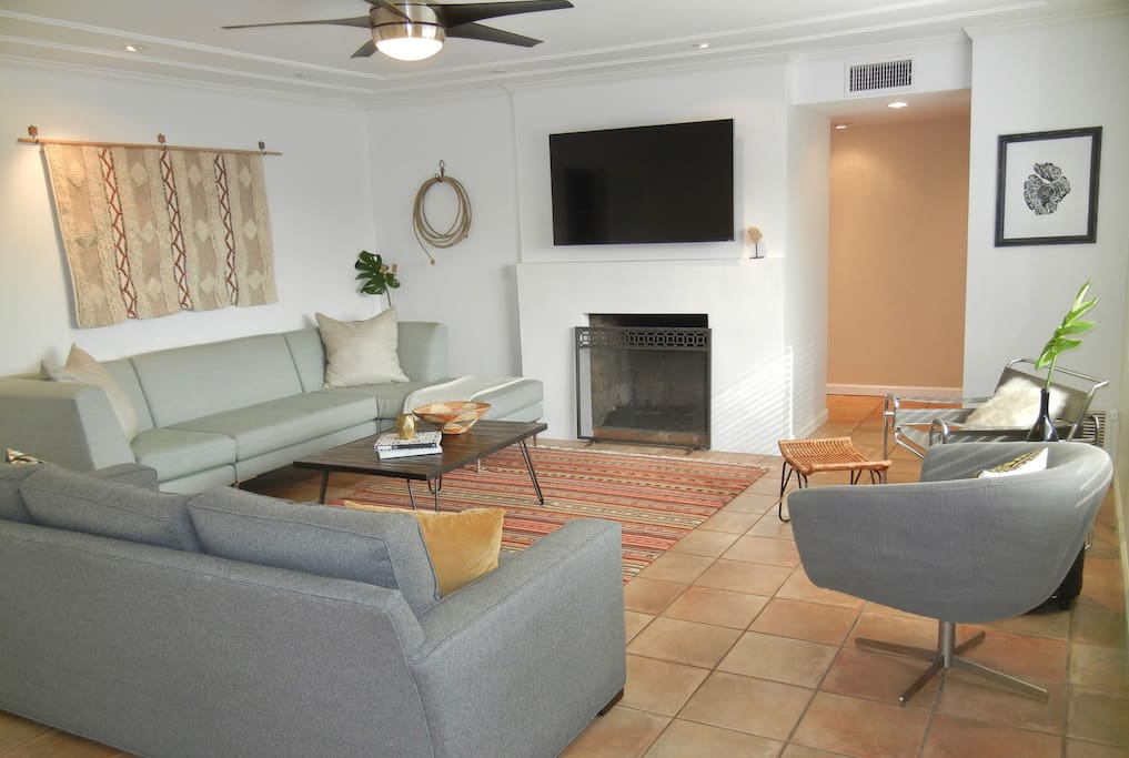 """Unwind in the main room to watch a movie. 55"""" flat screen with wifi."""