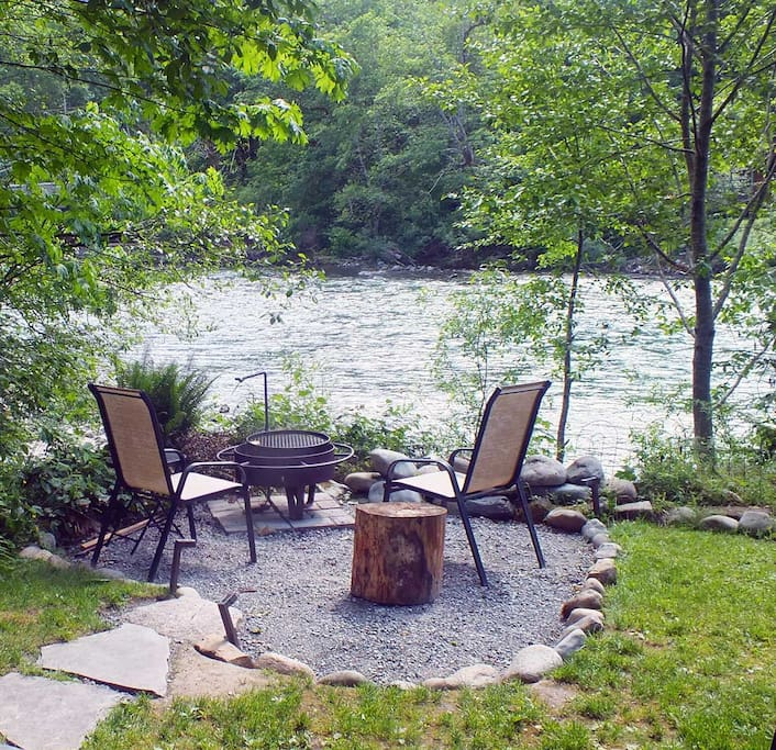 Fire pit area next to river bank with high spring river level