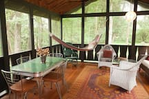 No better place to relax in warm weather:  the screened in porch.