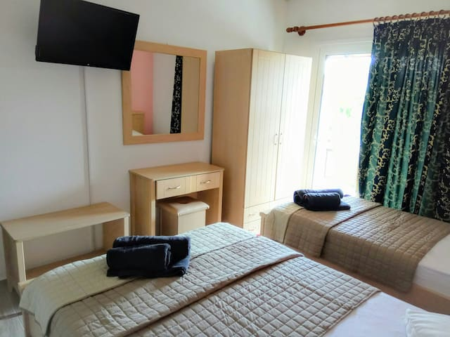 The room has one double and one single beds.