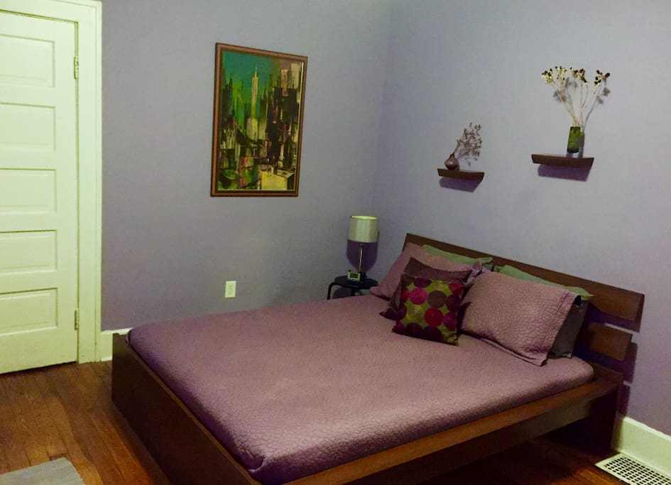 Queen-sized platform bed mere feet from bathroom. Two closets.