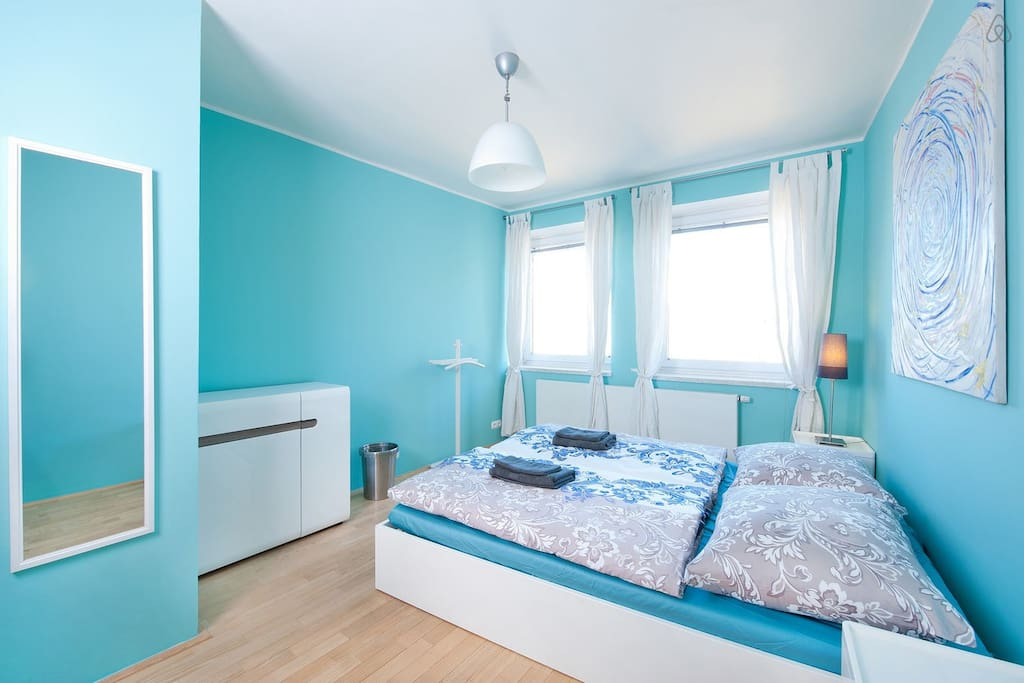 Colorful first bedroom with sheets provided of course!